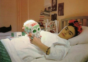 Frida Kahlo recuperating in bed with a sugar skull after another one ...