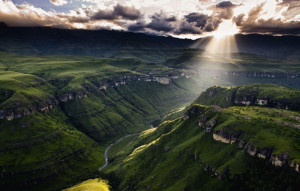 Sun shining through the clouds in Drakensberg, South Africa