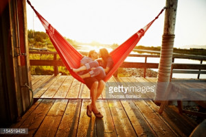 husband and wife couple kissing in hammock caption husband and wife ...