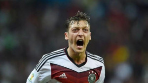 Mesut Ozil celebrates after smashing a deflected clearance into the ...
