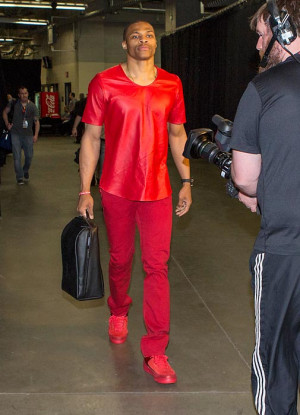 Why does Cam Newton dress like a professional businesswoman?