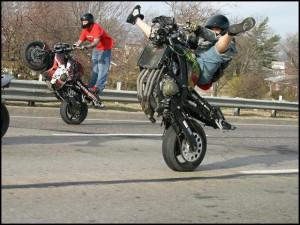 STRANGE MOTORCYCLE 'WHEELIE' FUN - WHERE'S THE FRONT WHEEL?
