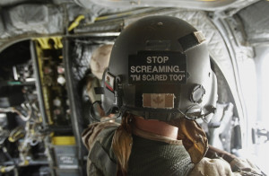 Canadian Army crewman stands inside a CH-47 Chinook helicopter ...
