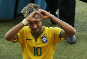 Brazil's Neymar forms a heart with his hands as he leaves the pitch ...