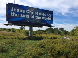One of trucker Harold Scott's Christian message billboards sits on a ...
