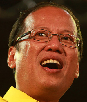 Filipino presidential candidate Benigno 'Noynoy' Aquino III raises the ...