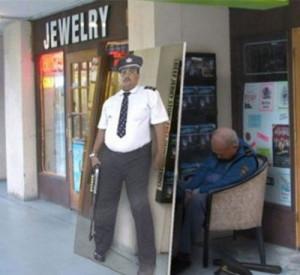 Funny photos funny cop sleeping cardboard cutout