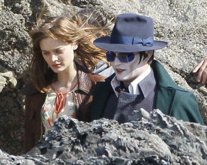 Love on the rocks: Johnny Depp strolls with his leading lady as he ...