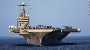 The USS Abraham Lincoln, a Nimitz-class aircraft carrier, is seen near ...