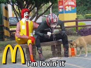 Funny photos funny McDonalds Ronald guy bike helmet