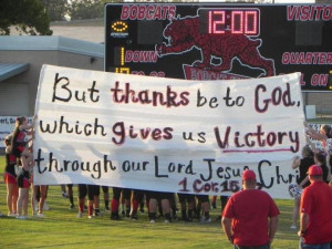 ... up banners with Bible verses on them to pump up the football team