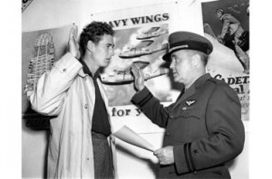 Ted Williams (l.) reenacts taking the oath to enlist in the U.S. Navy