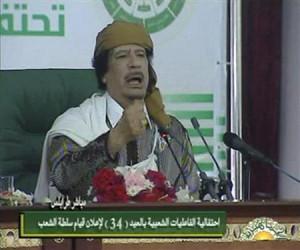 Libyan leader Muammar Gaddafi speaks at an event in Tripoli in this ...