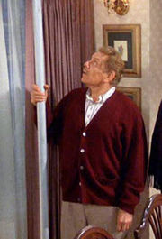Frank Costanza holding the Festivus pole.