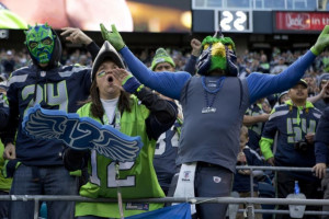 Spirited Seattle Seahawks fans cheer on the players during their game ...