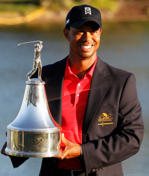 Tiger Woods holds the trophy after winning the Arnold Palmer ...