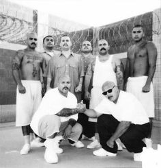 CHOLOS.... LOOKS 2 ME THEY R IN PRISON More