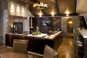 Natural stone, rustic style in this basement family room. Reclaimed ...