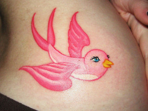 ... and flying wings this is a really pretty and girly sparrow tattoo