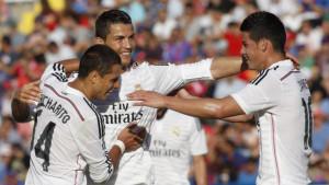 Real Madrid's Cristiano Ronaldo, center, Chicharito, left, and James ...