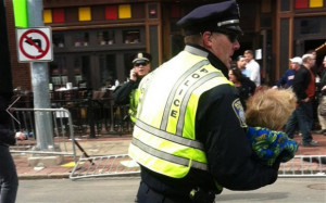 police officer carries a child to safety after the Boston Marathon ...