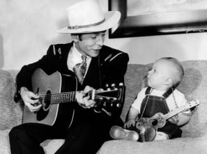 Hank Williams in happy times with the infant son, Hank Williams Jr