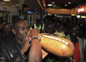 Kenya's 800m runner David Rudisha drinks milk from a traditional gourd ...