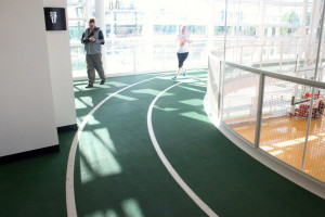 track above the court, where a Nike employee was running laps. Nike ...