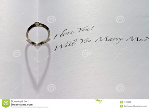 ... heart shadow in book with the sentence I Love You! Will You Marry Me