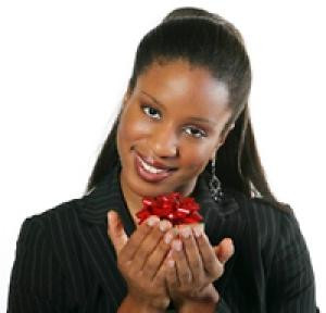 Beautiful, smiling black woman holds a small red package with a big ...