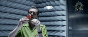Screencap of Rockhound, holding a solved Rubik's cube in his hands.