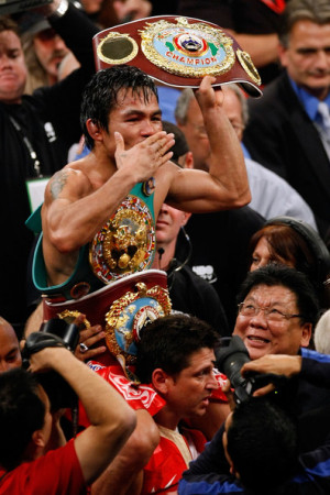 Manny Pacquiao Manny Pacquiao celebrates his 12 round TKO victory