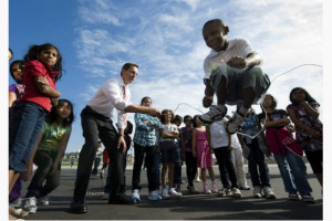 Ontario Premier Dalton McGuinty holds the skipping rope for students ...