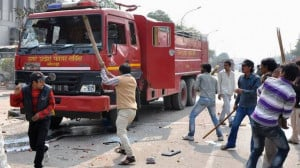 Protesters damage a fire engine during a strike in Noida, on the ...
