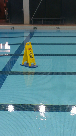 Funny picture #6333 tags: wet floor swimming pool sign float floating