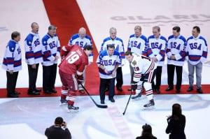 1980 USA Olympic hockey team player Mike Eruzione drops the puck for ...