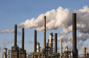 Oil refinery with smoke stacks against a blue sky ©iStockphoto.com ...