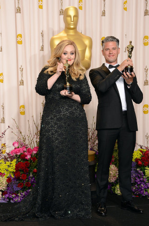 adele and paul epworth posed together with their oscars