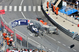 ... hits the wreckage after Pastor Maldonado's collision with Max Chilton