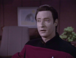 Why is Data's uniform gold and not red?