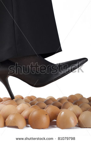 Well dressed woman walking on egg shells, white background. - stock ...
