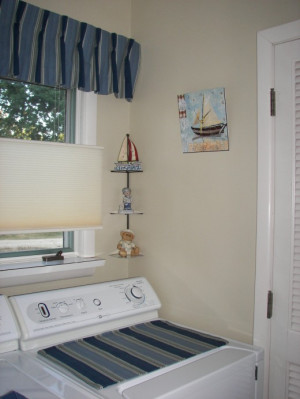 Nautical Laundry Room with Blue Stripes and Sailboats