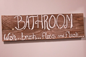 Bathroom sign out of old barn wood.
