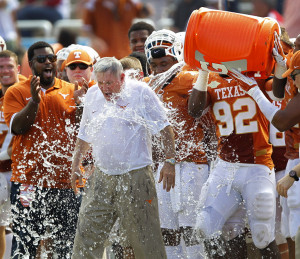 Texas head coach Mack Brown is doused with the water cooler by his ...