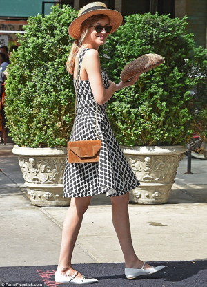No fad diets here! Dakota Johnson looks stunning in sundress and hat ...