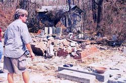 John Anderson, youngest son of Walter Anderson, surveying the damage ...