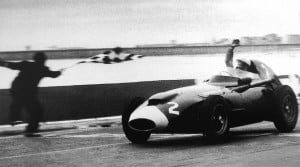 Stirling Moss takes the chequered flag to win the Portuguese Grand ...