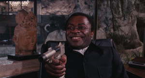 Live_and_Let_Die_-_Kananga_threatens_Bond_with_his_own_weapon.png