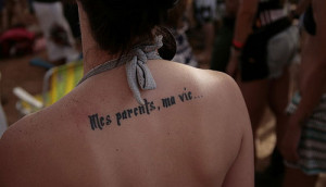 This tattoo is in french and says my parents, my life