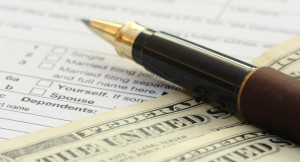 tax-form-with-pen-and-dollars-u-s-individual-income-tax-return-form ...